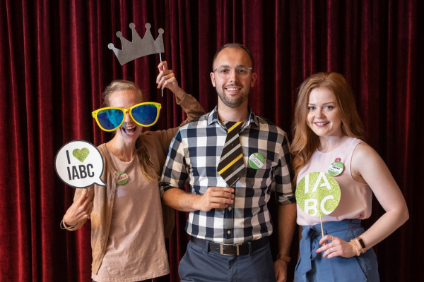 IABC members with photobooth props